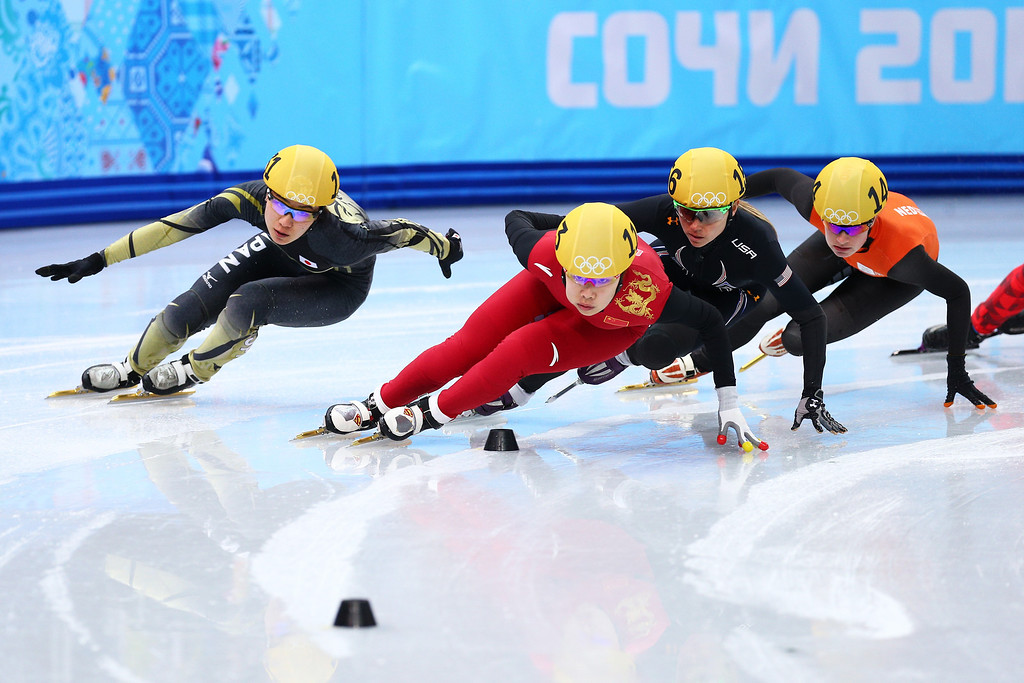 . SOCHI, RUSSIA - FEBRUARY 15:  (L-R) Yui Sakai of Japan, Yang Zhou of China, Jessica Smith of the United States and Yara van Kerkhof of the Netherlands skate during the Ladies\' 1500m Short Track Speed Skating heats on day 8 of the Sochi 2014 Winter Olympics at the Iceberg Skating Palace on February 15, 2014 in Sochi, Russia.  (Photo by Paul Gilham/Getty Images)