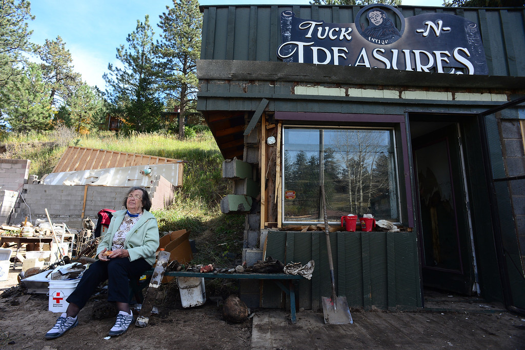 . GLEN HAVEN, CO - OCTOBER 8: Jewel Sumonia sits outside of what used to be her antique shop Tuck N\' Treasures gift shop next to the historic Glen Haven Inn in Glen Haven, CO on October 8, 2013.  She lost her shop but many of the antiques inside made it.   (Photo By Helen H. Richardson/ The Denver Post)