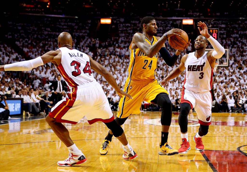. MIAMI, FL - MAY 30: Paul George #24 of the Indiana Pacers drives to the basket as Ray Allen #34 and Dwyane Wade #3 of the Miami Heat defend during Game Six of the Eastern Conference Finals of the 2014 NBA Playoffs at American Airlines Arena on May 30, 2014 in Miami, Florida.  (Photo by Mike Ehrmann/Getty Images)