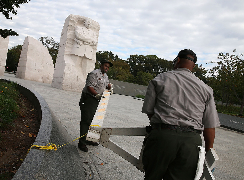 . U.S. Park Service workers remove a barricade that was used to close the Martin Luther King Memorial on the morning after a bipartisan bill was passed by the House and the Senate to reopen the government and raise the debt limit, on October 17, 2013 in Washington, DC. President Obama signed the bill into law, that will fund the government until January 15, 2014 and allow the government to pay bills until February 7, 2014.  (Photo by Mark Wilson/Getty Images)