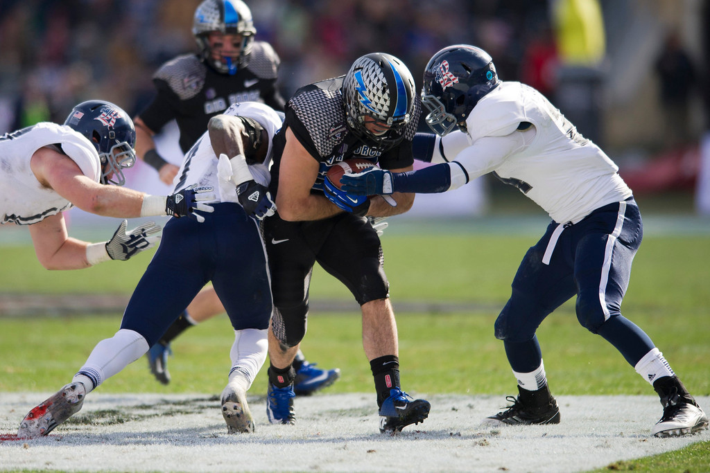 . Mike DeWitt #25 of the Air Force Falcons tries to break free against the Rice Owls defense on December 29, 2012 during the Bell Helicopter Armed Forces Bowl at Amon G. Carter Stadium in Fort Worth, Texas.  (Photo by Cooper Neill/Getty Images)