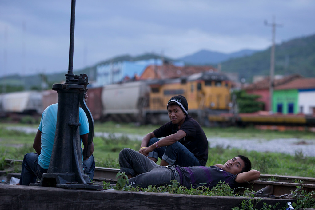 . In this Wednesday, June 18, 2014 photo, young Central American migrants hang out on the train tracks as they await the arrival of a northbound freight train, in Arriaga, Chiapas State, Mexico. Vice President Joe Biden flew to Guatemala last Friday to emphasize the dangers of the northbound journey and the low chances of staying in the U.S for good. It\'s a tough sell for Central Americans who say life at home has simply become intolerable. (AP Photo/Rebecca Blackwell)