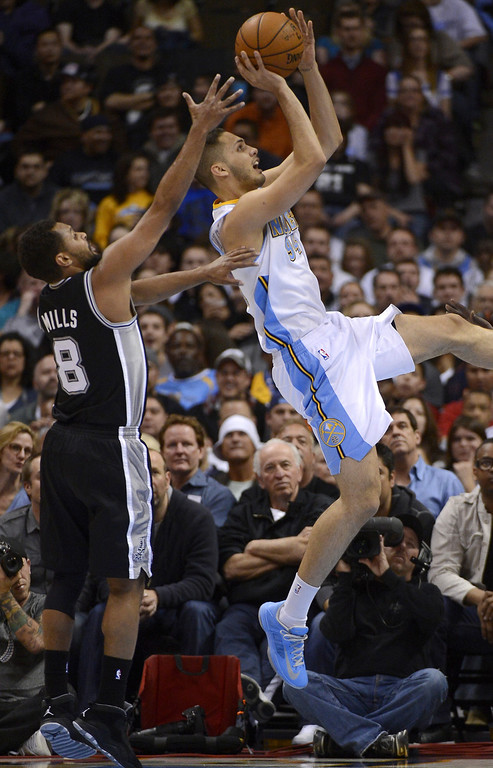 . Denver Nuggets Evan Fournier (94) takes a shot past San Antonio Spurs Patty MIlls (8) during the second quarter April 10, 2013 at Pepsi Center. (Photo By John Leyba/The Denver Post)