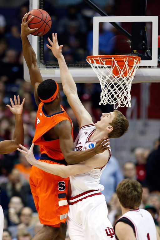 . C.J. Fair #5 of the Syracuse Orange goes to the hoop against Cody Zeller #40 of the Indiana Hoosiers during the East Regional Round of the 2013 NCAA Men\'s Basketball Tournament at Verizon Center on March 28, 2013 in Washington, DC.  (Photo by Rob Carr/Getty Images)