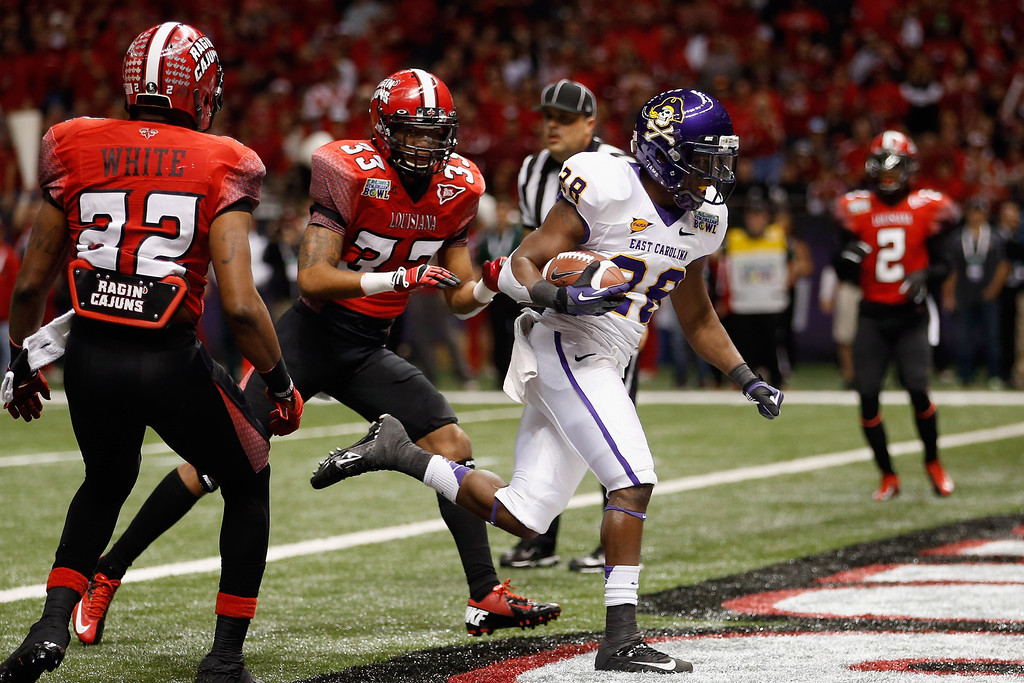 . Reggie Bullock #28 of the East Carolina Pirates scores a touchdown  against the Louisiana-Lafayette Ragin Cajuns during the R+L Carriers New Orleans Bow at the Mercedes-Benz Superdome on December 22, 2012 in New Orleans, Louisiana.  (Photo by Chris Graythen/Getty Images)