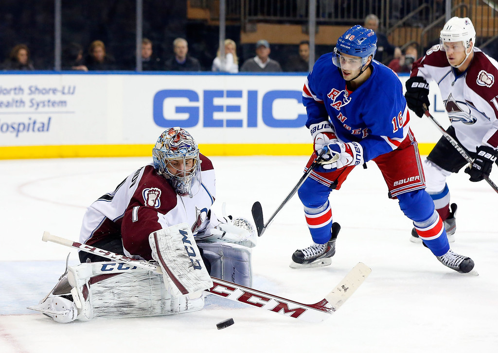 . Semyon Varlamov #1 of the Colorado Avalanche makes a save in the second period under pressure from Derick Brassard #16 of the New York Rangers at Madison Square Garden on February 4, 2014 in New York City.  (Photo by Jim McIsaac/Getty Images)
