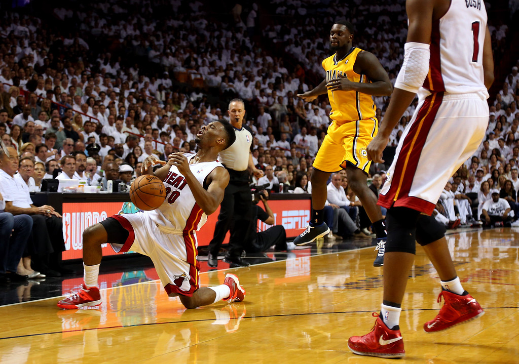 . MIAMI, FL - MAY 30: Norris Cole #30 of the Miami Heat falls down after being hit in the face by Lance Stephenson #1 of the Indiana Pacers during Game Six of the Eastern Conference Finals of the 2014 NBA Playoffs at American Airlines Arena on May 30, 2014 in Miami, Florida.  (Photo by Mike Ehrmann/Getty Images)