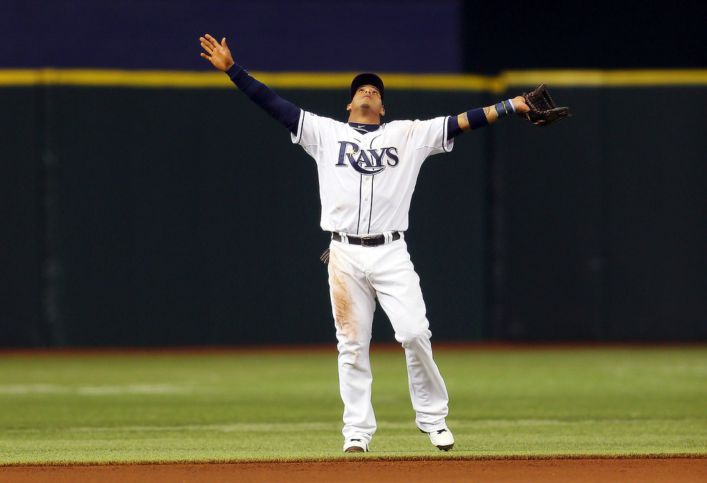 . Yunel Escobar #11 of the Tampa Bay Rays calls for a fly ball in the first inning against the Boston Red Sox during Game Four of the American League Division Series at Tropicana Field on October 8, 2013 in St Petersburg, Florida.  (Photo by Mike Ehrmann/Getty Images)