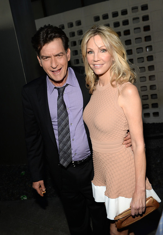 """. Actors Charlie Sheen and Heather Locklear arrive for the premiere of Dimension Films\' \""""Scary Movie 5\"""" at ArcLight Cinemas Cinerama Dome on April 11, 2013 in Hollywood, California.  (Photo by Michael Buckner/Getty Images)"""