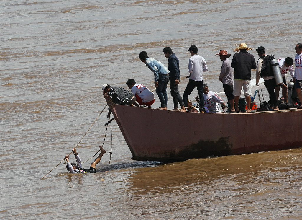 . A diver clings to a rope during a search operation for a Lao Airlines plane that crashed and sank in the Mekong River in Pakse, Laos Thursday, Oct. 17, 2013. (AP Photo/sakchai Lalit)