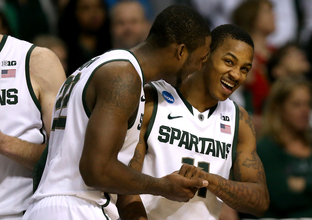 . AUBURN HILLS, MI - MARCH 23:  (L_R) Branden Dawson #22 and Keith Appling #11 of the Michigan State Spartans celebrate late in the game against the Memphis Tigers during the third round of the 2013 NCAA Men\'s Basketball Tournament at The Palace of Auburn Hills on March 23, 2013 in Auburn Hills, Michigan. Michigan State Spartans won 70-48. (Photo by Jonathan Daniel/Getty Images)