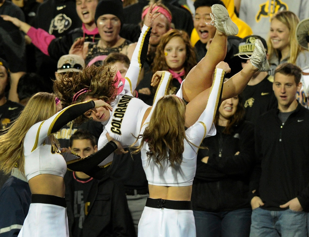 . BOULDER, CO. - OCTOBER 26: Colorado cheerleaders performed in the first half. The University of Colorado football team hosted Arizona Saturday night, October 26, 2013. Photo By Karl Gehring/The Denver Post