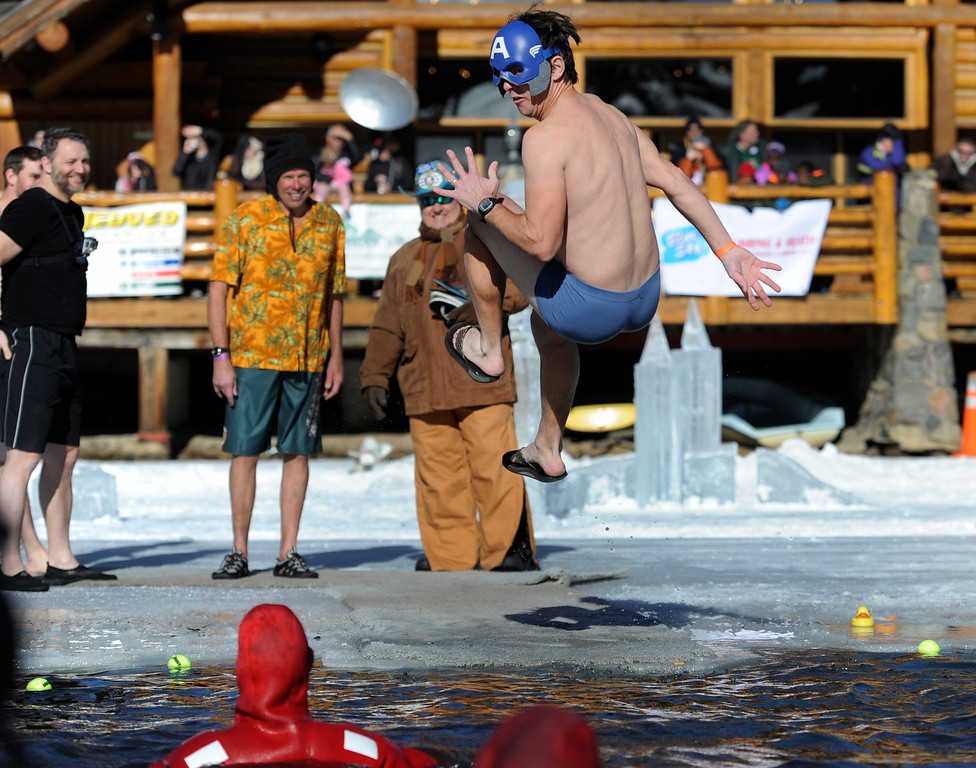 . Dozens joined in for the 6th annual Evergreen Lake Plunge on New Years Day, 2013, where only the very brave jumped, dove, and even performed a belly flop into the icy waters of Evergreen Lake.Dressed as Captain Avenger, Nick Ramey of Arvada added a twist to his plunge.  Kathryn Scott Osler, The Denver Post