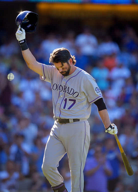 . Colorado Rockies\' Todd Helton acknowledges fans after striking out in his last at-bat, during the ninth inning of the Rockies\' baseball game against the Los Angeles Dodgers, Sunday, Sept. 29, 2013, in Los Angeles.  (AP Photo/Mark J. Terrill)