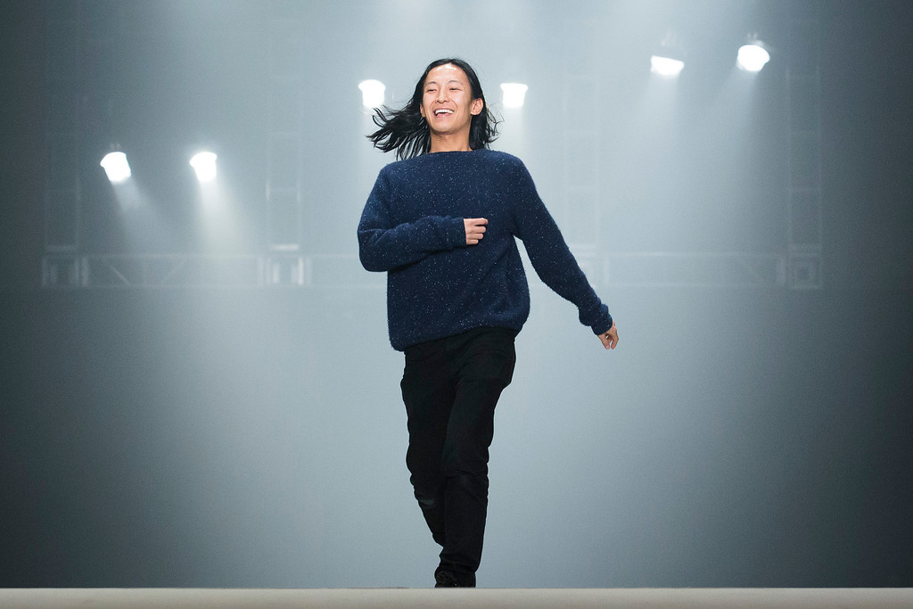 . Designer Alexander Wang greets the audience following his Fall 2013 fashion show during Fashion Week, Saturday, Feb. 9, 2013, in New York. (AP Photo/John Minchillo)