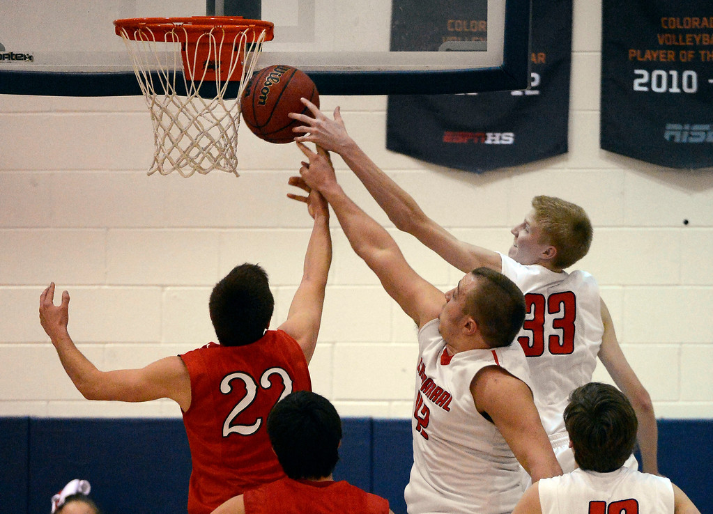 . Brighton\'s Jedidiah Grein (22) battles for a rebound with Chaparra\'s Mitch Parsons (42) and Hayden Dalton(33) February 27, 2013. (Photo By John Leyba/The Denver Post)