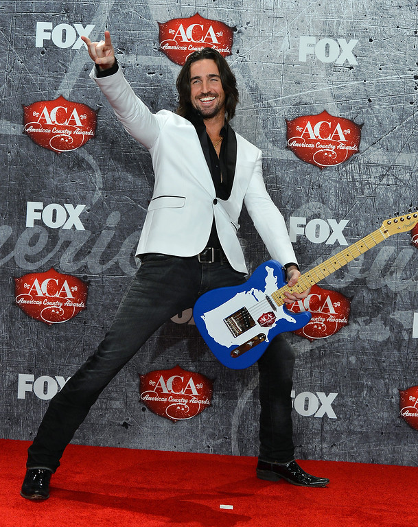 . LAS VEGAS, NV - DECEMBER 10:  Recording artist Jake Owen poses in the press room with his award for Breakthrough Artist of the Year during the 2012 American Country Awards at the Mandalay Bay Events Center on December 10, 2012 in Las Vegas, Nevada.  (Photo by Frazer Harrison/Getty Images)