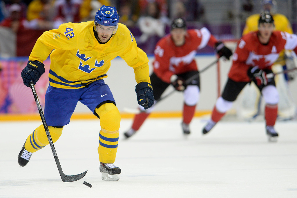 . Jimmie Ericsson (42) of Sweden skates into the open ice with the puck against Canada during the second period of the men\'s ice hockey gold medal game. Sochi 2014 Winter Olympics on Sunday, February 23, 2014 at Bolshoy Ice Arena. (Photo by AAron Ontiveroz/ The Denver Post)