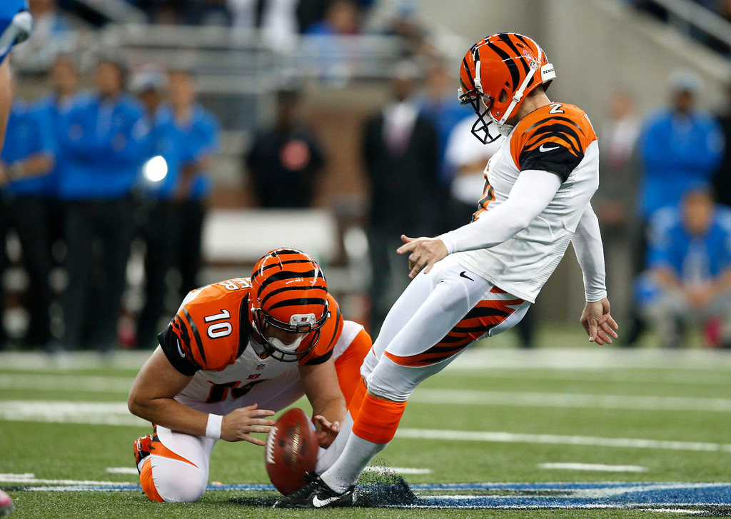 . Cincinnati Bengals kicker Mike Nugent (2) kicks a 54-yard field goal out of the hold of Kevin Huber (10) against the Detroit Lions in the fourth quarter of an NFL football game against Sunday, Oct. 20, 2013, in Detroit. Cincinnati beat Detroit 27-24. (AP Photo/Rick Osentoski)