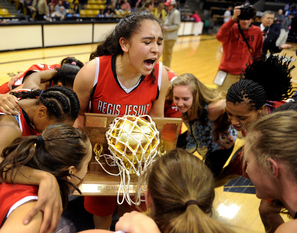 . BOULDER, CO. - MARCH 16: The Raiders celebrated with the trophy after the win over Highlands Ranch. The Regis Jesuit High School girl\'s basketball team defeated Highlands Ranch 53-46 in the 5A championship game Saturday, March 16, 2013 at the Coors Events Center in Boulder.  (Photo By Karl Gehring/The Denver Post)