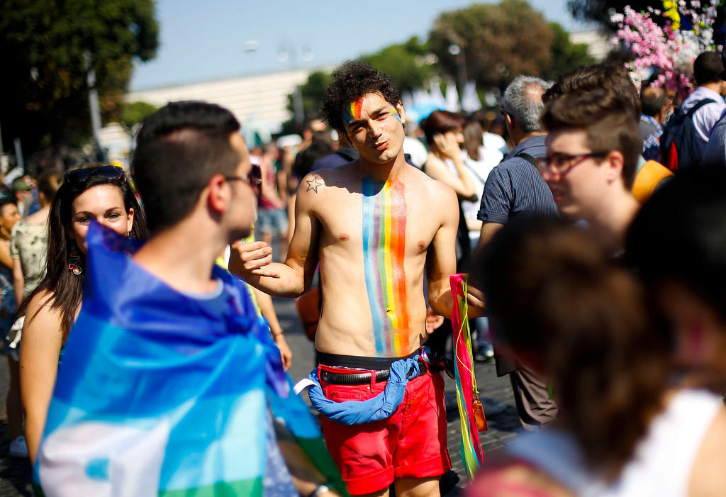 . People walk during the annual gay pride parade in downtown Rome June 15, 2013. REUTERS/Max Rossi