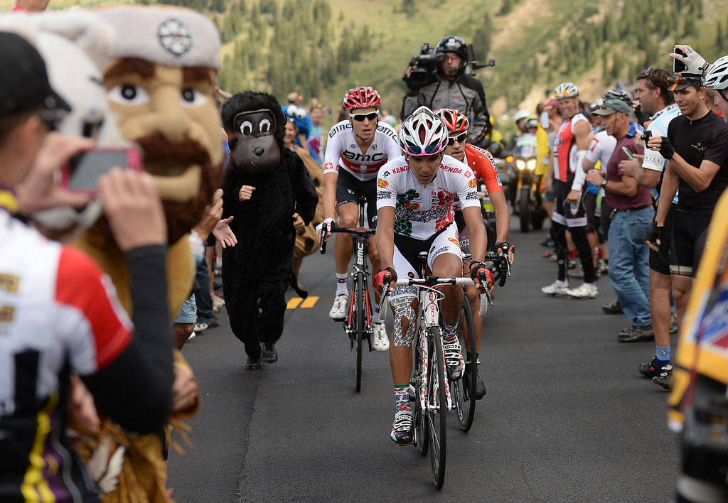 . From front, Luis Lemus of Jelly Belly Cycling p/b Kenda, Matt Cooke of Jamis-Hagens Berman p/b Sutter Home and Michael Schar of BMC Racing Team ride up Independence Pass for the King of Mountain portion of the second stage of the 2013 USA Pro Challenge race from Aspen to Breckenridge.  (Photo By Hyoung Chang/The Denver Post)