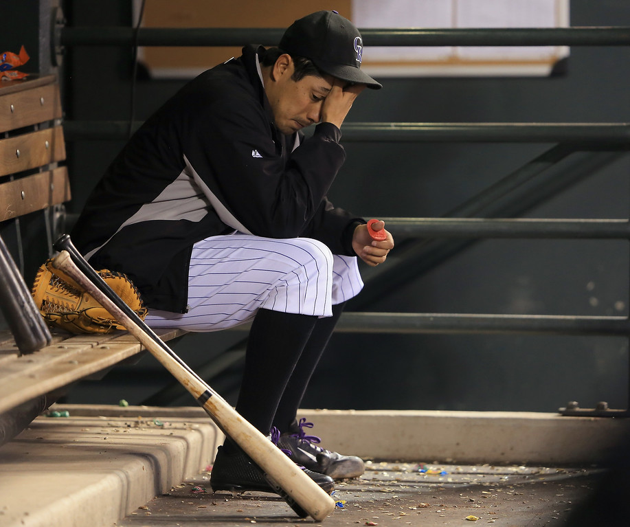 . Starting pitcher Jorge De La Rosa #29 of the Colorado Rockies sits in the dugout after being removed from the game against the Washington Nationals in the sixth inning at Coors Field on June 12, 2013 in Denver, Colorado.  (Photo by Doug Pensinger/Getty Images)