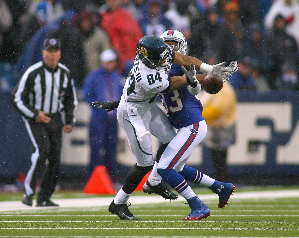 . Cecil Shorts #84 of the Jacksonville Jaguars can\'t make a catch against  Ron Brooks #33 of the Buffalo Bills at Ralph Wilson Stadium on December 2, 2012 in Orchard Park, New York. Brooks was called for interference on the play. (Photo by Rick Stewart/Getty Images)