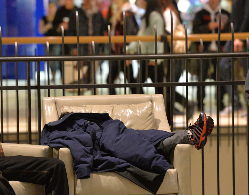 . A child who\'s parents did not wish to be identified, sleeps in a chair on Thanksgiving day at FlatIron Crossing mall.  November 28, 2013. David R. Jennings/Boulder Daily Camera
