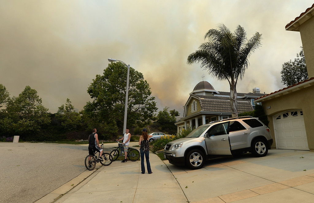 . Residents watch as a wildfire approaches homes on May 2, 2013 in Newbury Park, California. (Photo by Kevork Djansezian/Getty Images)