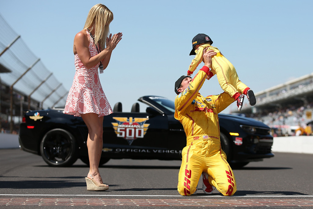 . Ryan Hunter-Reay, driver of the #28 DHL Andretti Autosport Honda Dallara, celebrates with hid son Ryden after winning the 98th running of the Indianapolis 500 Mile Race at Indianapolis Motorspeedway on May 25, 2014 in Indianapolis, Indiana.  (Photo by Chris Graythen/Getty Images)