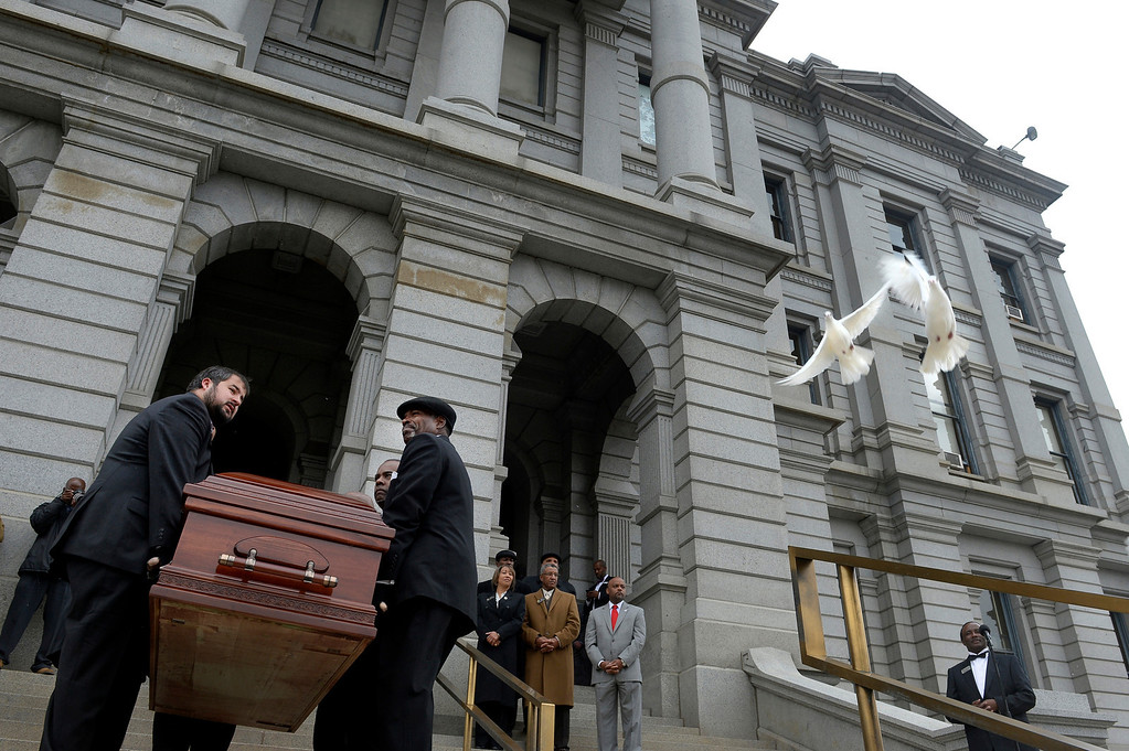 . A pair of doves fly overhead as pallbearers carry the casket of former Lt. Gov. Joe Rogers into the state Capitol in Denver, CO October 15, 2013. The public was invited to to pay their respects to Rogers at the Capitol where he would lie in state through the day. The Republican served as Gov. Bill Owens\' first lieutenant governor. He was 49. (Photo By Craig F. Walker / The Denver Post)