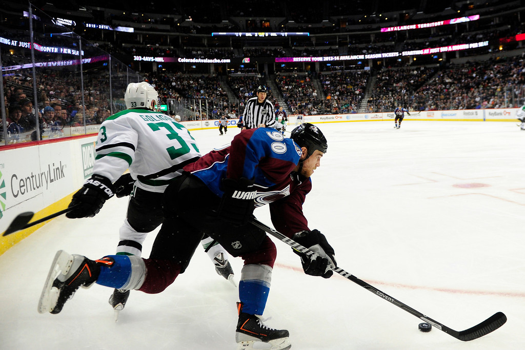 . DENVER, CO - DECEMBER 16: Colorado Avalanche center Ryan O\'Reilly (90) controls the puck as Dallas Stars defenseman Alex Goligoski (33) defends during the third period of the Avs\' 6-2 win. The Colorado Avalanche hosted the Dallas stars at the Pepsi Center. (Photo by AAron Ontiveroz/The Denver Post)
