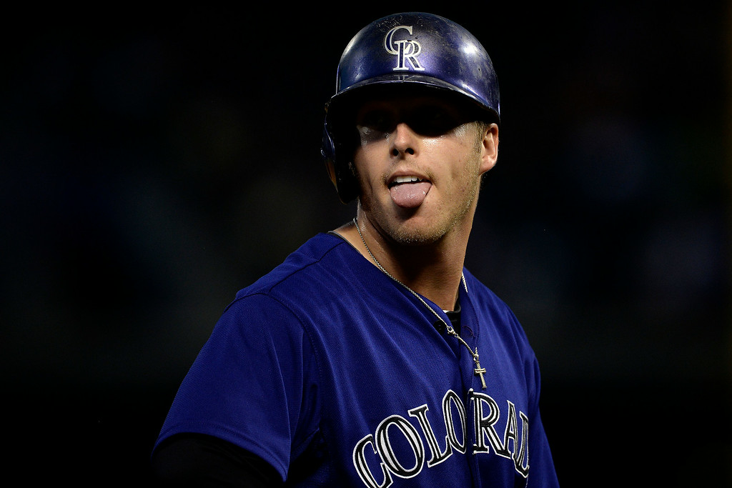 . Corey Dickerson (6) of the Colorado Rockies sticks his tongue out as he rests on third base against the Washington Nationals at Coors Field. Major League Baseball action between the Colorado Rockies and the Washington Nationals on Monday, July 21, 2014. (Photo by AAron Ontiveroz/The Denver Post)