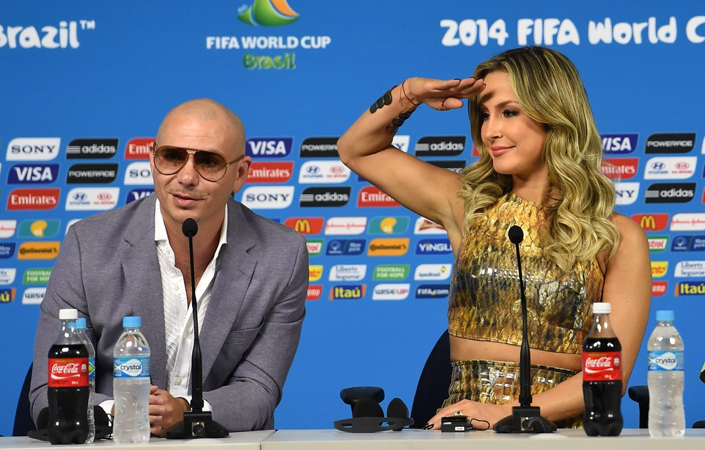 """. The performers of Brazil\'s World Cup official theme song \""""We are one\"""" Pitbull and Claudia Leitte, speak during a press conference in Sao Paulo, Brazil on June 11,  2014 on the eve of the opening match of the 2014 FIFA World Cup in Brazil. AFP PHOTO/PEDRO UGARTE/AFP/Getty Images"""