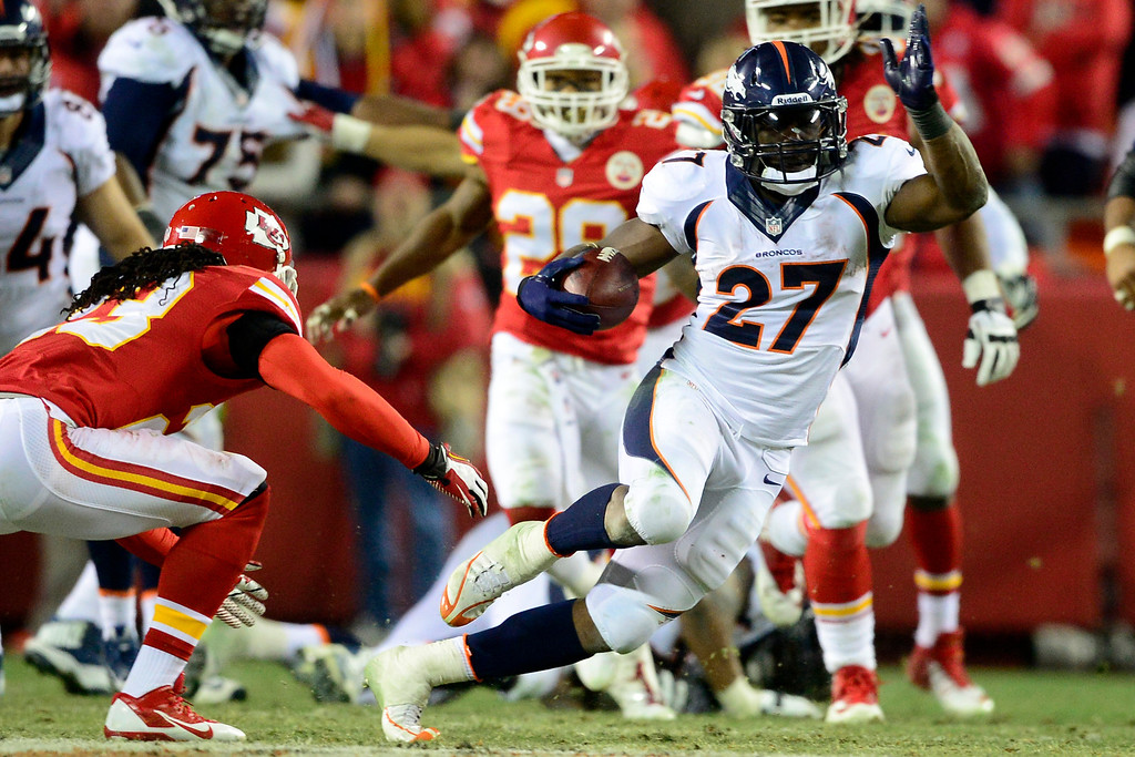 . Knowshon Moreno (27) of the Denver Broncos jukes Kendrick Lewis (23) of the Kansas City Chiefs for a long gain during the second half of the Broncos\' 35-28 win at Arrowhead Stadium. (Photo by AAron Ontiveroz/The Denver Post)