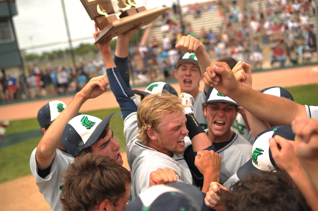 . DENVER, CO. - MAY 25: Andrew Jones(9) and ThunderRidge HIgh School baseball team celebrate winning of 5A baseball state championship game against Rocky Mountain HIgh School at All City Field. Denver, Colorado. May 25, 2013. ThunderRidge won 2-1. (Photo By Hyoung Chang/The Denver Post)