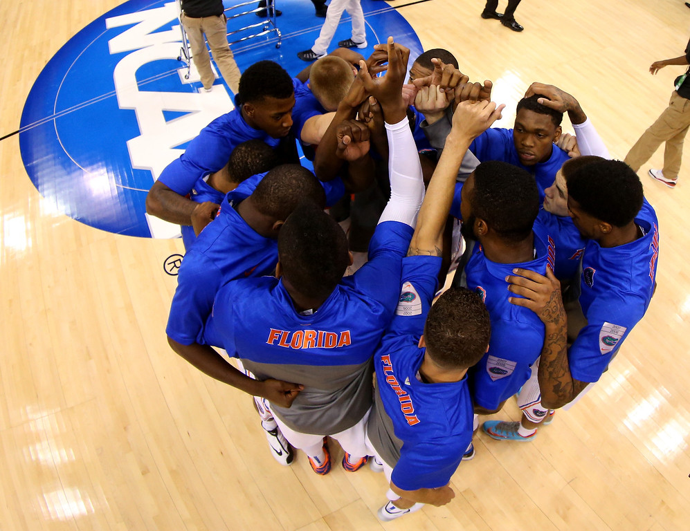 . ORLANDO, FL - MARCH 20:  The Florida Gators huddle on the court before taking on the Albany Great Danes during the second round of the 2014 NCAA Men\'s Basketball Tournament at Amway Center on March 20, 2014 in Orlando, Florida.  (Photo by Mike Ehrmann/Getty Images)