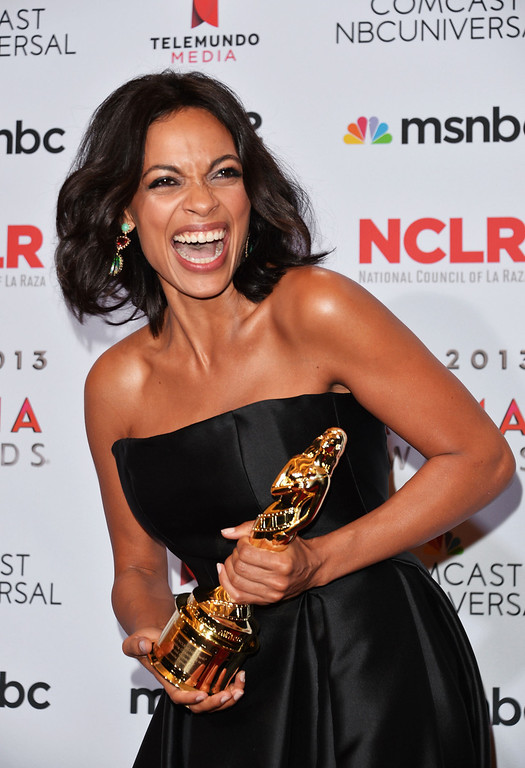 . PASADENA, CA - SEPTEMBER 27:  Actress Rosario Dawson (posing with the Outstanding Commitment to Cause and Community) attends the Winner\'s Walk during the 2013 NCLR ALMA Awards at Pasadena Civic Auditorium on September 27, 2013 in Pasadena, California.  (Photo by Alberto E. Rodriguez/Getty Images for NCLR)
