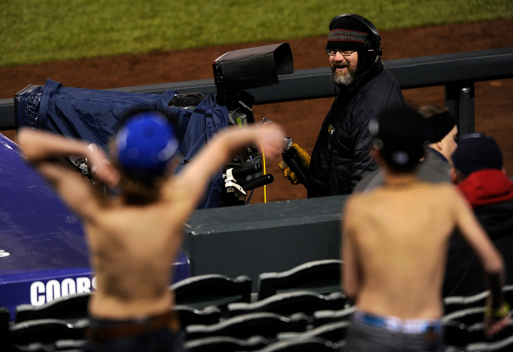 . DENVER, CO. - APRIL 23:  Unafraid of the cold, two boys made an effort to get on the big screen Tuesday night. The Atlanta Braves defeated the Colorado Rockies 10-2 in the second game of a doubleheader Tuesday night April 23, 2013 at Coors Field. Photo By Karl Gehring/The Denver Post