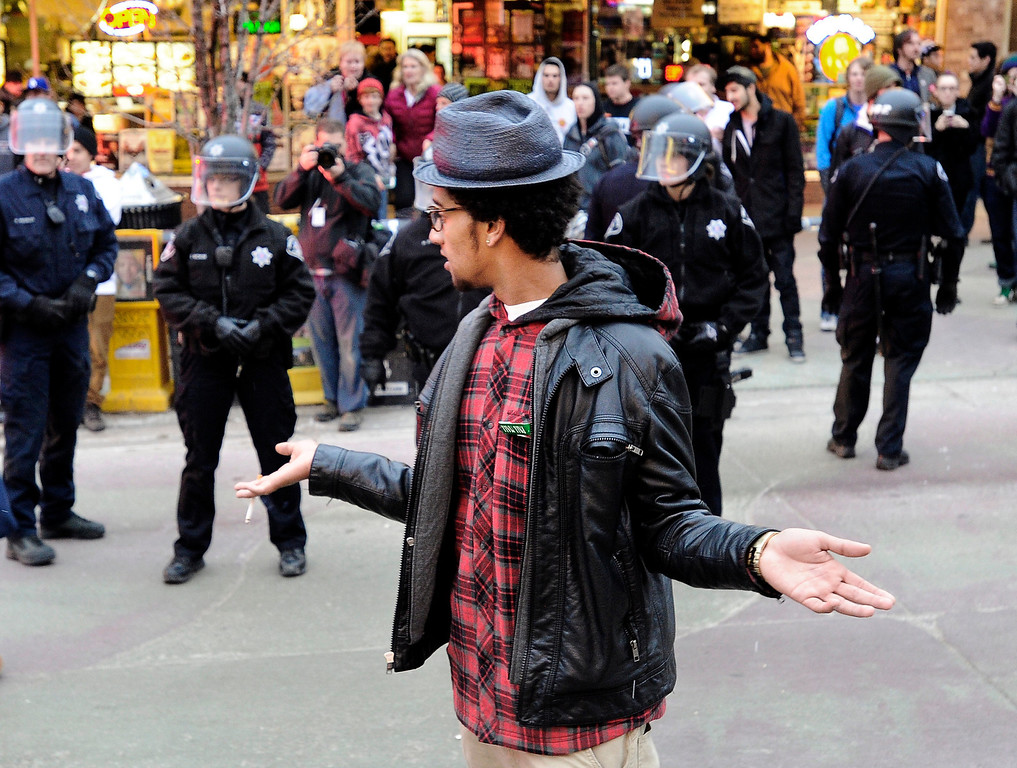 . An unidentified man taunts police during a disturbance at the Fox Theater on Monday, March 11, in Boulder. Boulder Police responded with riot gear to keep the fans of the band Tyler the Creator under control.  Jeremy Papasso/Boulder Daily Camera
