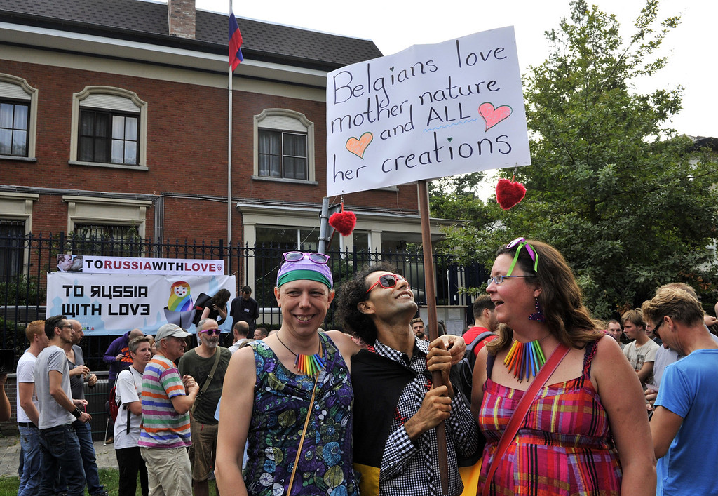 """. More than 300 gay and lesbian supporters participate in a  \'Kiss-In\' action at the Russian consulate in Antwerp to protest against the treatment of lesbian, gay, bisexual and transgender oriented people in Russia on August 9, 2013.  Russia on Friday said it was unperturbed by threats of an Olympic boycott over a controversial law banning \""""homosexual propaganda\"""", despite wide-ranging criticism of the legislation from athletes to US President Barack Obama. GEORGES GOBET/AFP/Getty Images"""