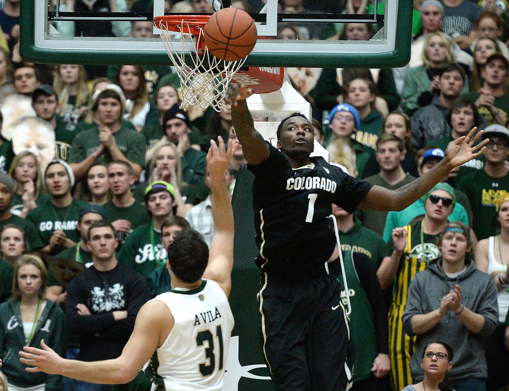 . Colorado\'s Wesley Gordon rejects the shot of J.J. Avila during an NCAA game against CSU on Tuesday, Dec. 3, 2013, at the Moby Arena in Fort Collins.