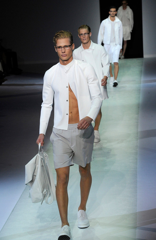 . Models wear creations for Emporio Armani men\'s Spring-Summer 2014 collection part of the Milan Fashion Week, unveiled in Milan, Italy, Monday, June 24, 2013.  (AP Photo/Giuseppe Aresu)
