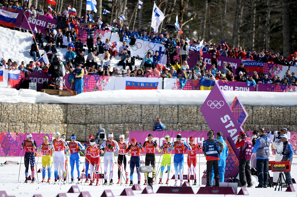 . SOCHI, RUSSIA - FEBRUARY 15:  Cross country skiers wait for the start on the first leg in the Women\'s 4 x 5 km Relay during day eight of the Sochi 2014 Winter Olympics at Laura Cross-country Ski & Biathlon Center on February 15, 2014 in Sochi, Russia.  (Photo by Harry How/Getty Images)