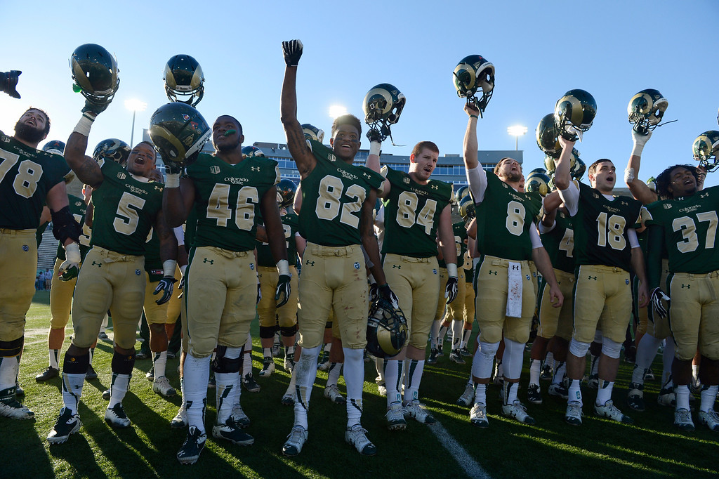 . The Colorado State Rams football team celebrate their victory over the Air Force Falcons with the fans Saturday afternoon, November 30, 2013. The Rams won 58-13. (Photo By Andy Cross/The Denver Post)