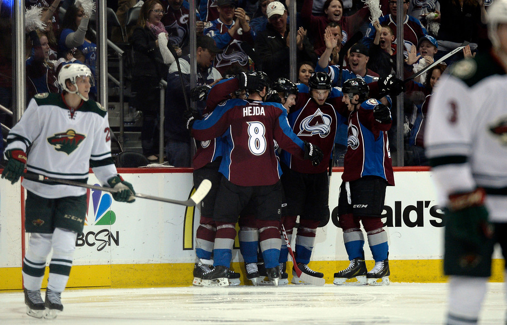 . Teammates congratulate Gabriel Landeskog (92) of the Colorado Avalanche after scoring his first goal in the second period of action.  (Photo by John Leyba/The Denver Post)