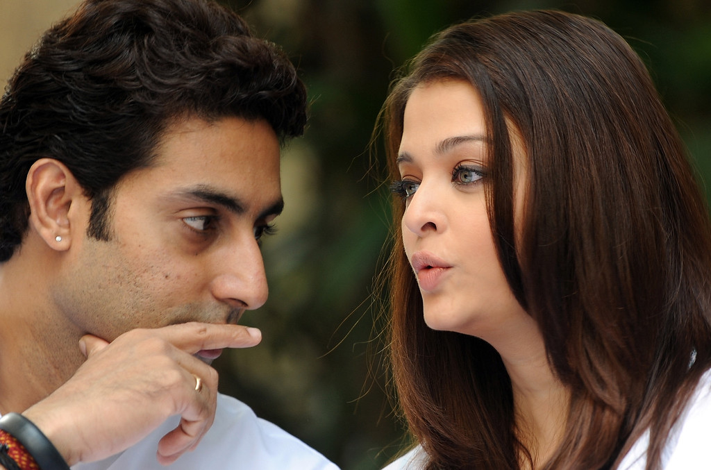 . Indian Bollywood actor Abhishek Bachchan (L) speaks with his wife and former Miss World Aishwarya Rai Bachchan before a press conference in Mumbai on February 9, 2013. The Bachchan family pledged to donate the proceeds of a book to the Plan India charity organisation, which supports the protection and rights of newborn girls in the country. Married women in India face huge pressure to produce male heirs, who are seen as breadwinners while girls are often viewed as a burden to the family as they require hefty dowries to be married off.  INDRANIL MUKHERJEE/AFP/Getty Images