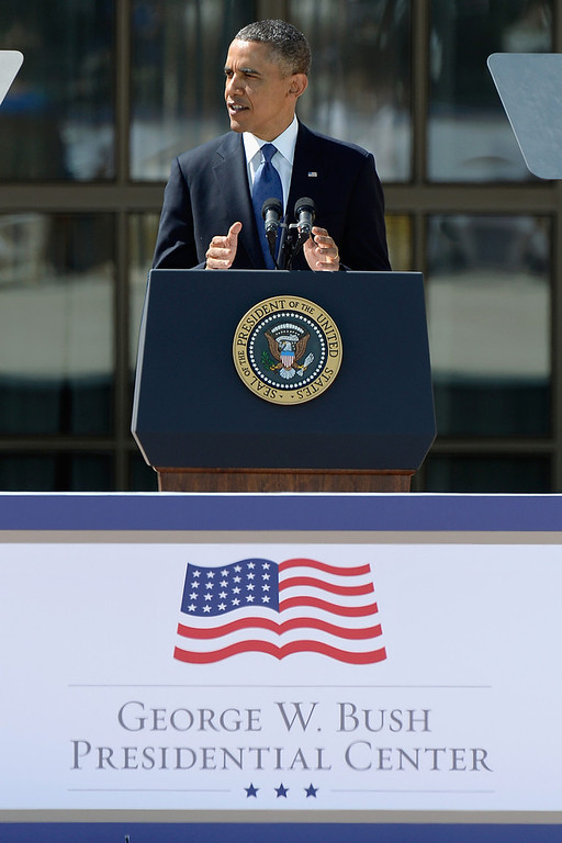 . U.S. President Barack Obama speaks during the opening ceremony of the George W. Bush Presidential Center April 25, 2013 in Dallas, Texas. The Bush library, which is located on the campus of Southern Methodist University, with more than 70 million pages of paper records, 43,000 artifacts, 200 million emails and four million digital photographs, will be opened to the public on May 1, 2013. The library is the 13th presidential library in the National Archives and Records Administration system.  (Photo by Kevork Djansezian/Getty Images)