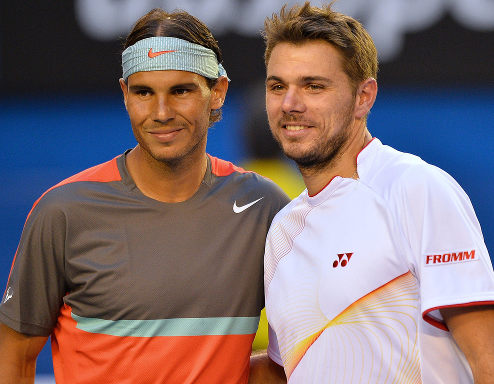 . Spain\'s Rafael Nadal (L) and Switzerland\'s Stanislas Wawrinka pose for photographs before the men\'s singles final on day 14 of the 2014 Australian Open tennis tournament in Melbourne on January 26, 2014.   SAEED KHAN/AFP/Getty Images